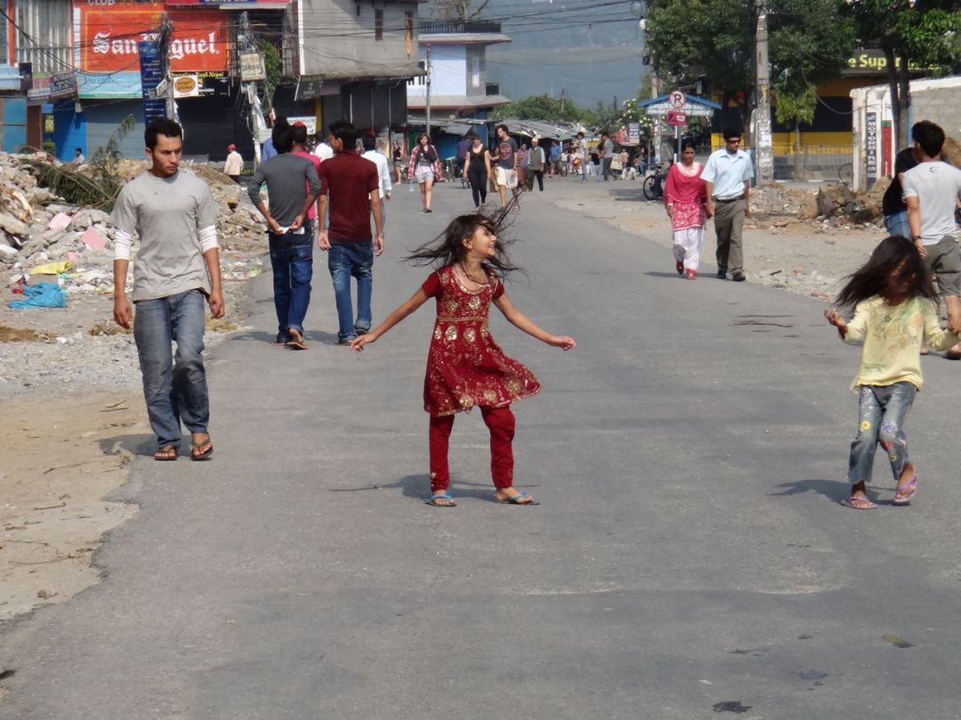 A bandha meant school was out for the day. These two little girls took advantage of the opportunity to dance in the street without any traffic to fear.
