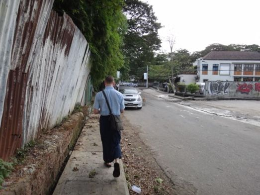 Scott walking down the street in his longyi.