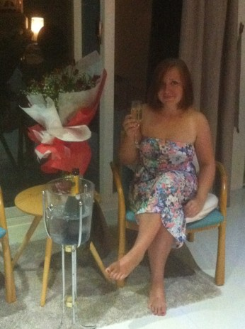 Enjoying the roses and champagne