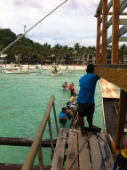 Boarding the boat from white beach