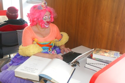 """You look like you've never seen a clown read a dictionary before."" Thanks to QP Doll from HappySpace for being a good sport."