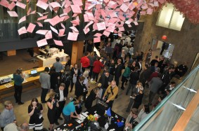 The crowd explores lots of fun digital activities in the atrium