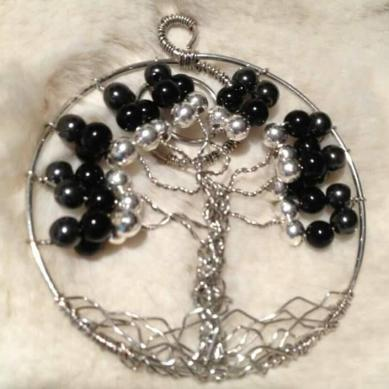 black and silver tree of life pendent