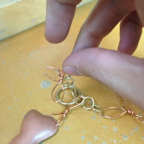 wire bow as clasp of the necklace