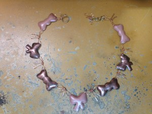 finished copper bow necklace