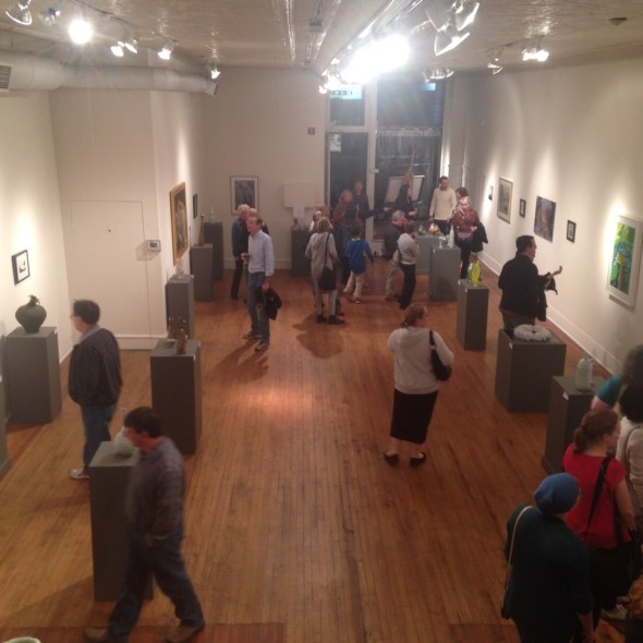 view of people viewing artwork in gallery