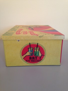 side of Retro and colorful art supplies tin box