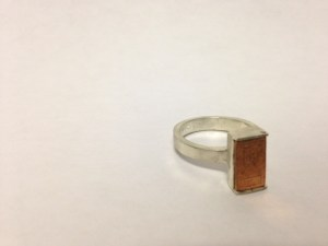 a ring with a copper door on it