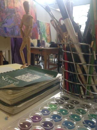 a desk of art supplies