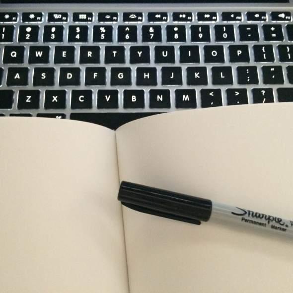 keyboard and sketchbook