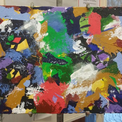 After painting over top of the collaged paint