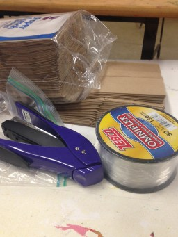 stapler, fishing line and paper bags