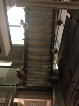 paper bag installation under a stairwell