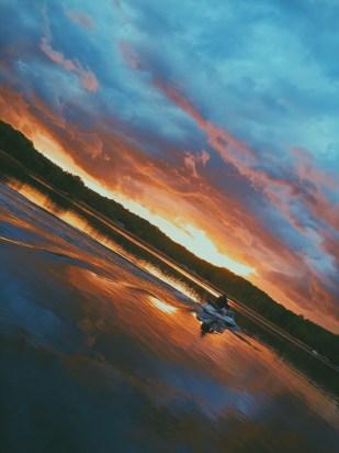 Blue to orange sunset with man on jetski