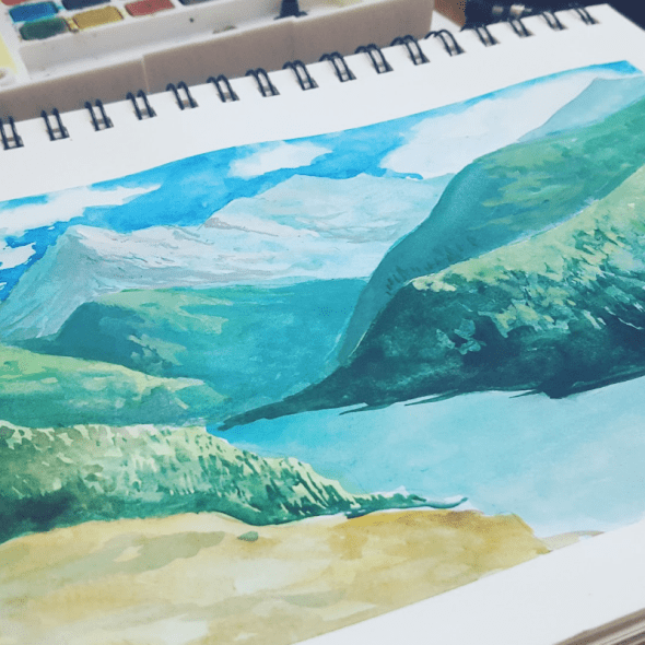 A watercolor drawing of mountains
