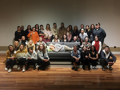 Group photo at end of forum, Richard is napping on couch
