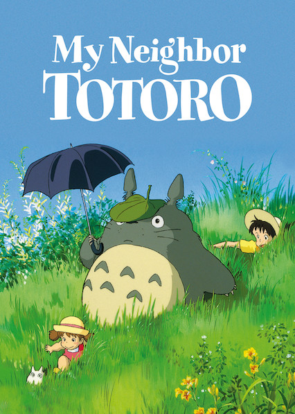 Totoro and two kids in a field