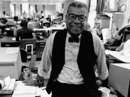 AP PHOTO_Chuck Stone poses in the newsroom of the Philadelphia Daily News_1984.