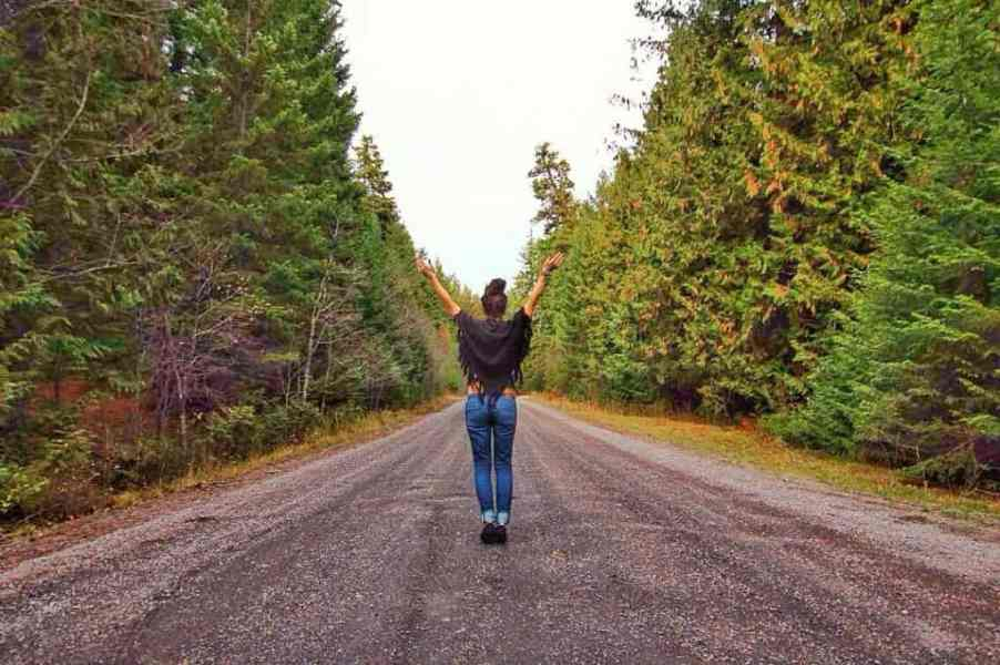 nina in road with forest