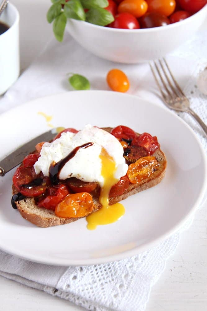 poached egg toast Roasted Tomatoes and Poached Eggs on Garlic Sourdough Toast