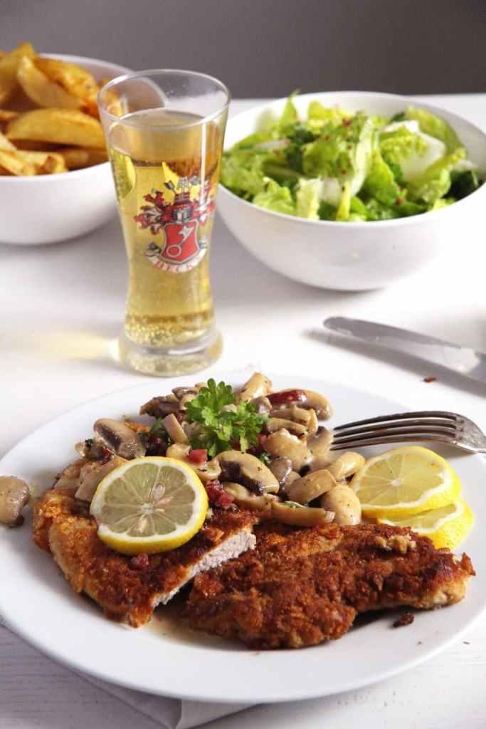schnitzel mushroom sauce 683x1024 Hunter Schnitzel – Classic German Jägerschnitzel with Mushroom Sauce
