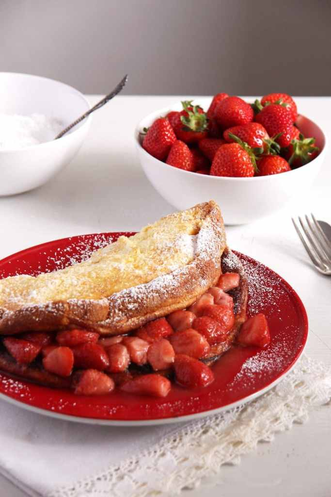strawberry pancakes sugar 683x1024 Fluffy Oven Pancakes with Strawberry Honey Sauce