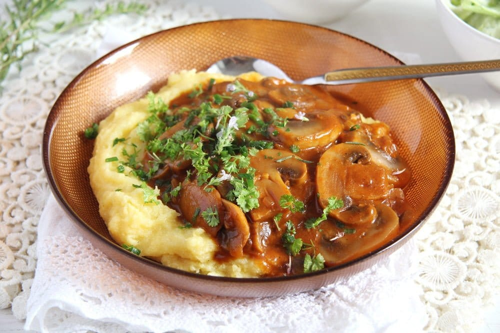 plate of mushroom stew with polenta