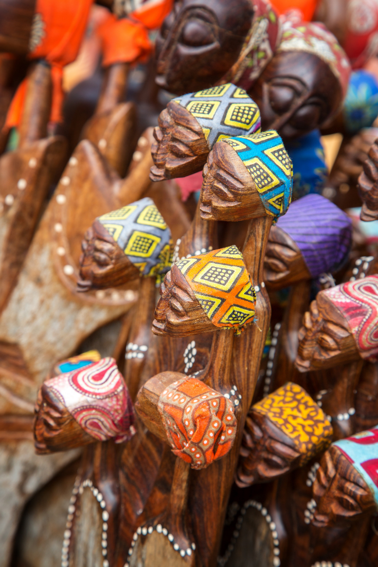 African souvenirs on sale at a Tanzanian market. A great place to start using your Swahili.