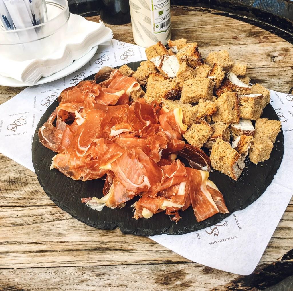 platter of ham and Portuguese bread at Manteigaria Silva Lisbon, Portugal Taste of Lisboa food tour