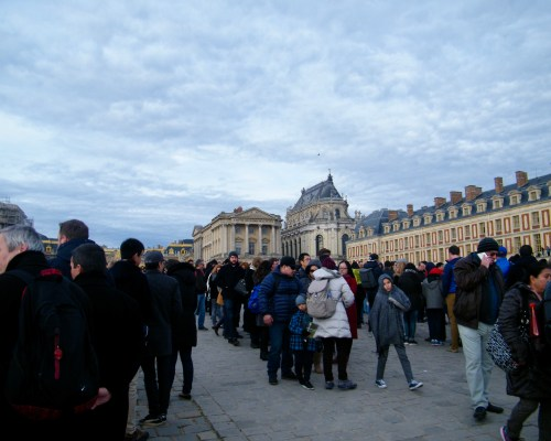 people standing in line at Versailles outside of Paris, France