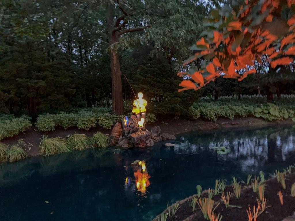 boy fishing Chinese Lantern at the Garden of Lights Montreal Botanical Garden