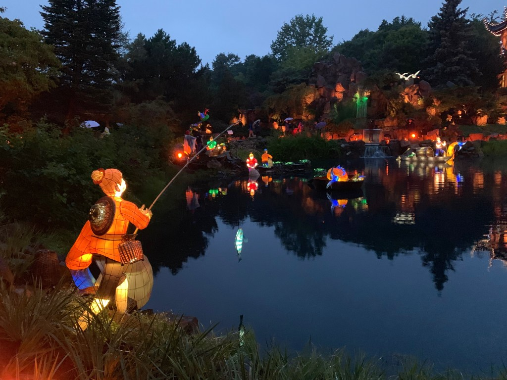 boy fishing Chinese lantern at the Montreal Botanical Garden Gardens of Life 2019