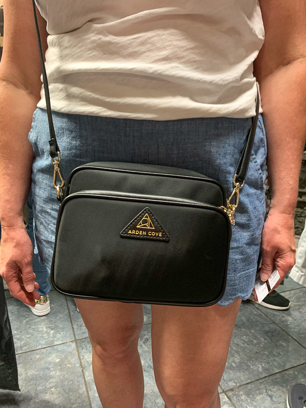 Woman wearing Arden Cove purse with an anti-theft features for traveling.