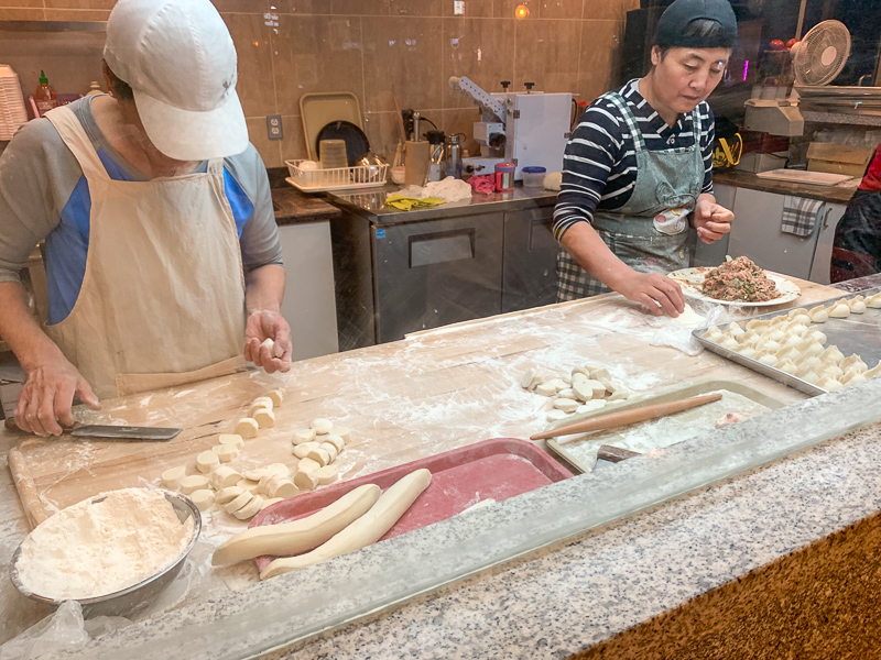 Montreal China Town people making dumplings at OhDumplings