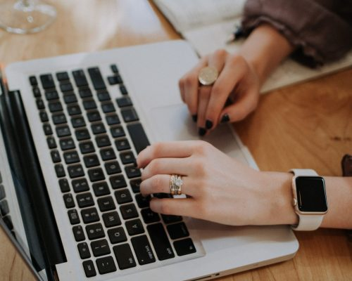 Woman using laptop. Travel tips for business travelers