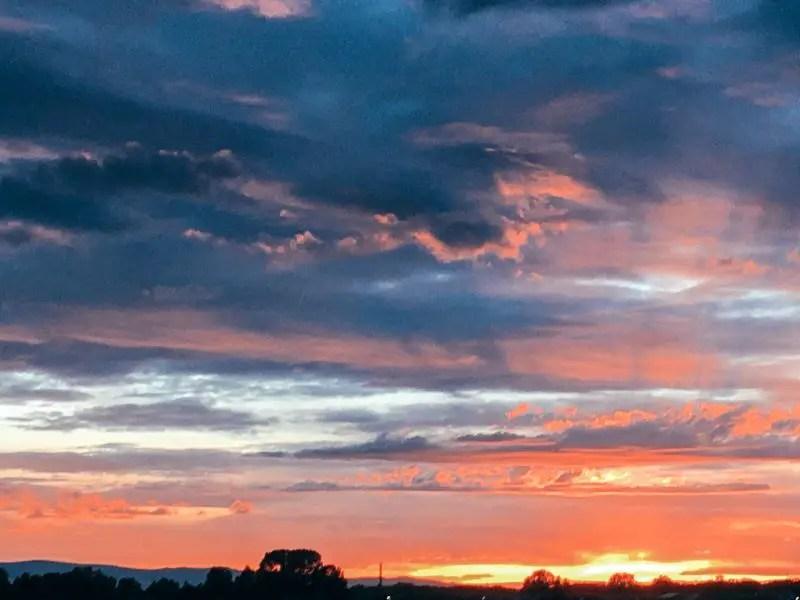 Orange and yellow streaked sunset in Laramie, Wyoming.