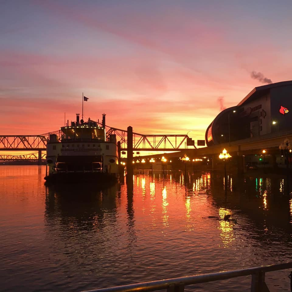 Belle of Louisville riverboat sailing from downtown Louisville along the Ohio River at sunset. A ride on the Belle is a great place to see fall color in Kentucky.
