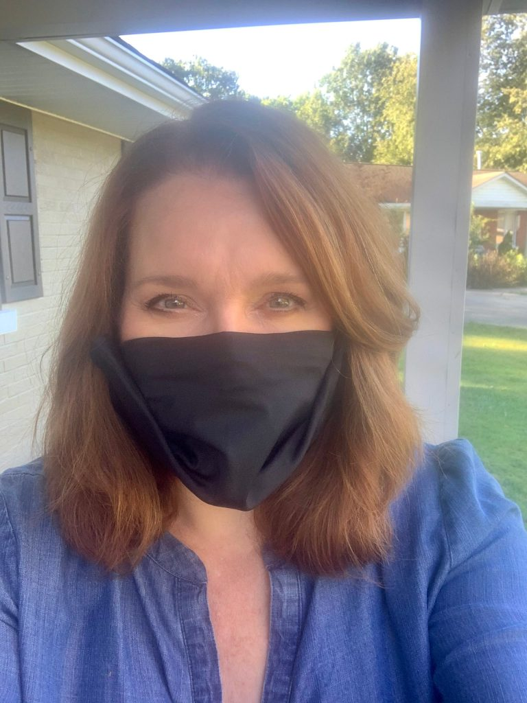 Woman wearing black face mask from TRTL. A great eco-friendly gift option.