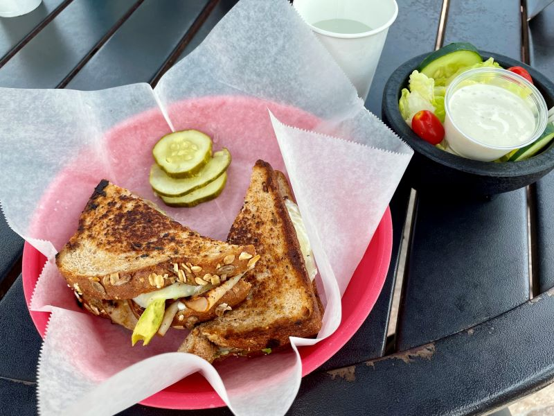 Grilled sandwich and salad at Tuckaway cafe one of the best places to eat in Ft Myers Beach