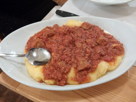 Polenta with sausage and ribs ragu