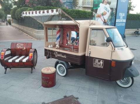 A barber-shop (in an Italian Ape Piaggio small truck)