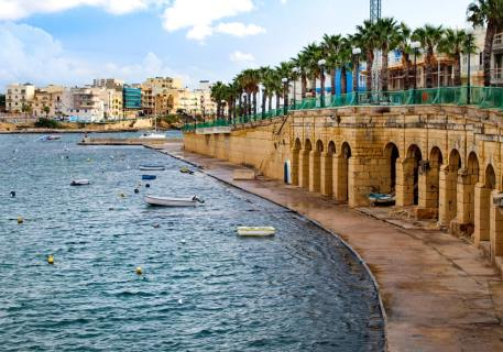 Marsaskala Harbor Promenade above and boat shelters below