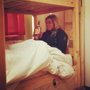 Slumber party. Giant blanket, jackets on and huge bottles of wine.