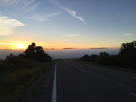 Sunrise above the fog in the valley