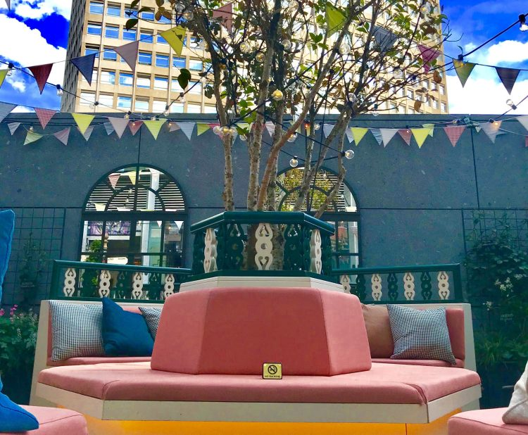 Pink Sofa on a rooftop