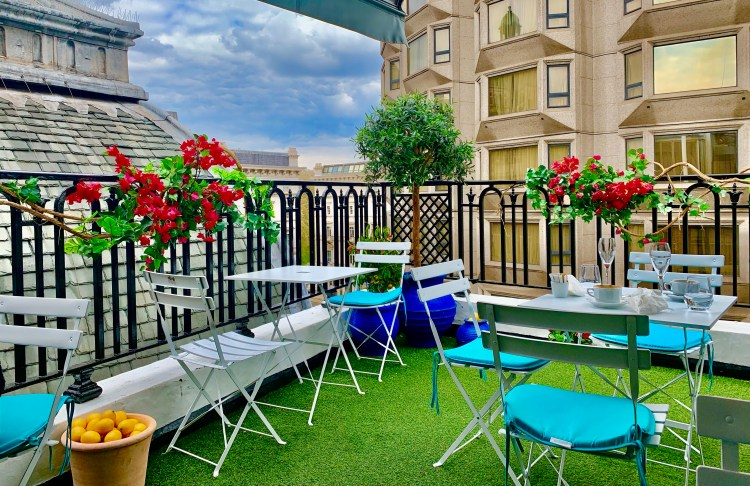 Colourful chairs and tables on a rooftop terrace