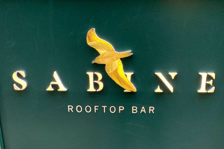 Sabine rooftop bar sign with a bird over