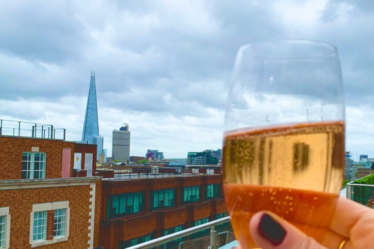 Champagne glass with shard in the background