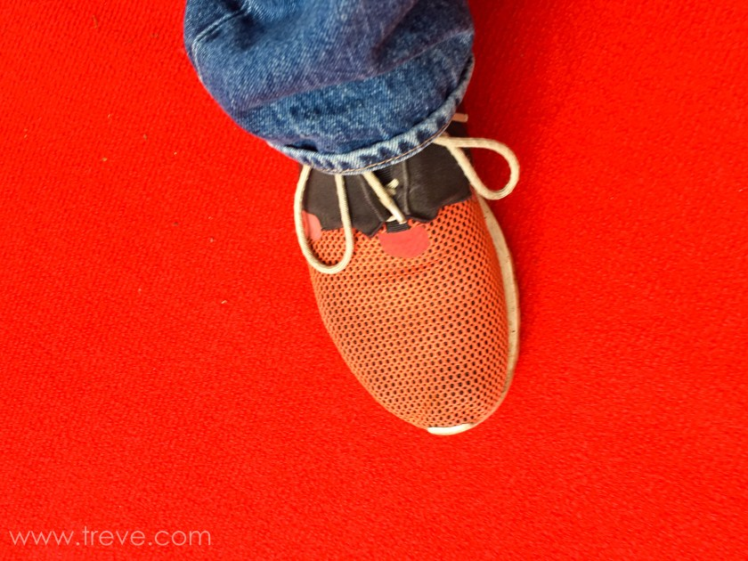 Red shoe on red carpet