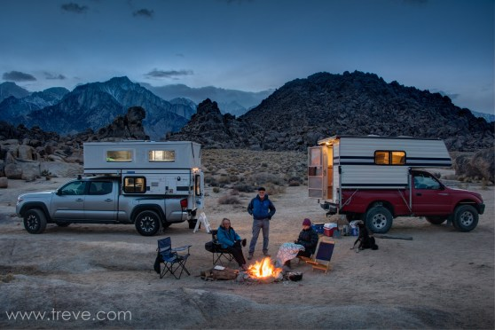 Truck campers in the Alabama Hills at dusk.